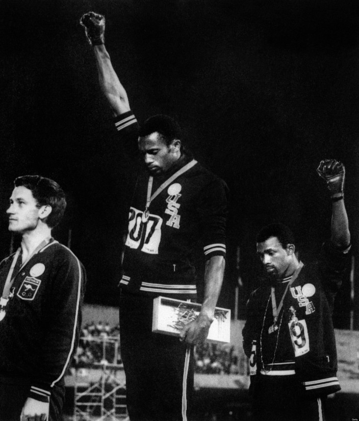 US athletes Tommie Smith (C) and John Ca